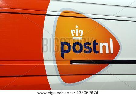 Almere Poort, Flevoland, The Netherlands - June 6, 2016: Orange PostNL logo on the side of a delivery van. Post.NL is the Dutch postal service.