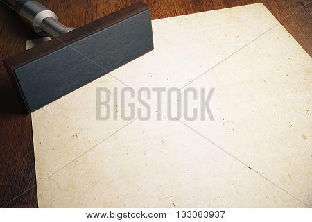 Rectangular stamper and aged blank paper sheet on wooden desktop. Mock up 3D Rendering