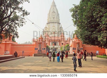VARANASI, INDIA - JANUARY 3, 2016: People going to Hindu temple New Vishwanath Mandirtreet in area of Hindu University Campus on January 3, 2016. Varanasi urban agglomeration had a population of 1435113