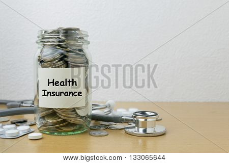 Money saving for health Insurance in the glass bottle