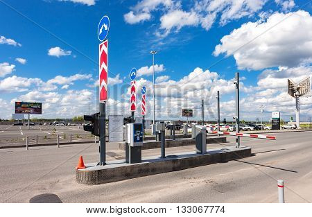SAMARA RUSSIA - MAY 22 2016: Checkpoint by the car parking in the terminal Samara Kurumoch Airport in summer sunny day