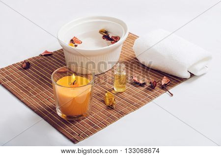 candle dish and towel on a bamboo mat