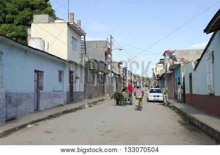 CIENFUEGOS - DECEMBER 2: Residents and tourists on the old colorful street on 2 December 2015 in Cienfuegos, Cuba.