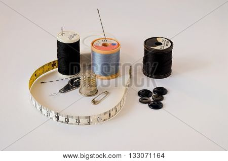 Selection of sewing accessories on white background