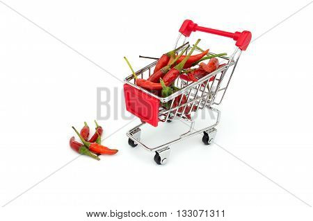 Red chilli in a shopping trolley on isolated white background. (Thai Vegetable)