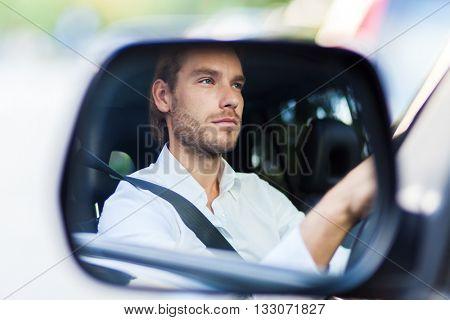 Portrait of a man driving his car