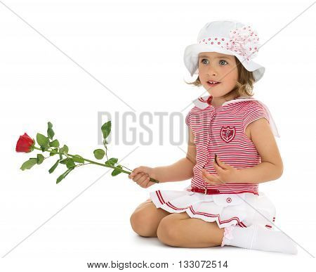 Beautiful little girl in a dressy summer dress and white Panama keeps in hand a rose - Isolated on white background