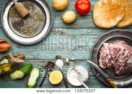 Ingredients for Gyros on the blue boards horizontal