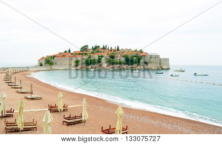 Luxury Sand Beach near Island and Resort Sveti Stefan in Budva, Montenegro. Balkans, Adriatic sea, Europe.