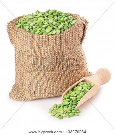 Beans in burlap sack with wooden scoop isolated on white background. Split peas in burlap bag