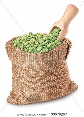 Beans with wooden scoop in burlap sack isolated on white background. Split peas in burlap bag