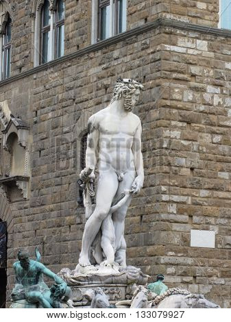 The Neptune fountain and Palazzo Vecchio in Florence Italy . Detail of the Neptune statue .