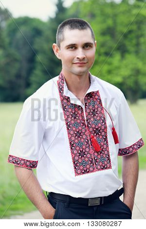 young handsome man in a Ukrainian embroidery