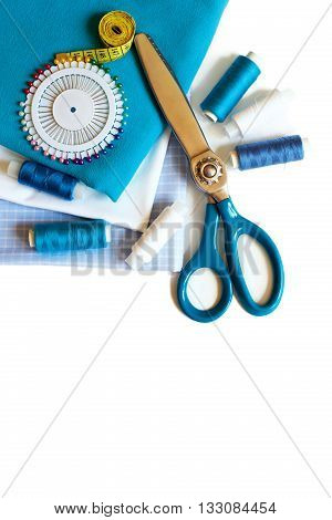 Sewing background with color threads meter pins and scissors