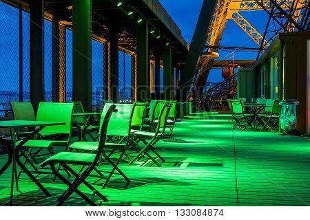 PARIS FRANCE - MAY 14 2013: This is night lights cafe on the first floor of the Eiffel Tower.