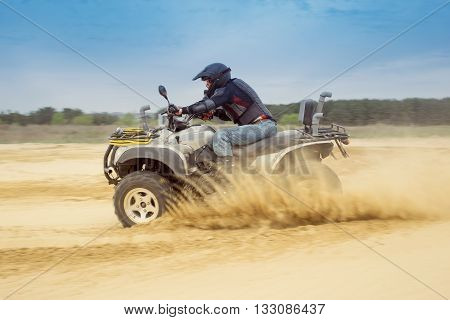 Racing ATV on the sand in summertime.