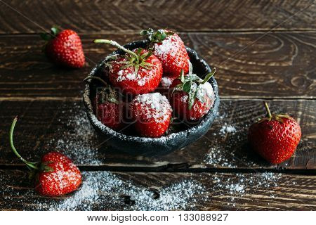 red strawberries strawberries on a brown background fragrant strawberries ripe strawberries strawberries with powdered sugar dessert of strawberries strawberries in powdered sugar.