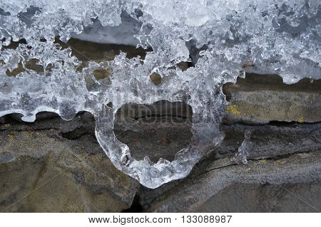 Melted ice has taken the form of a heart