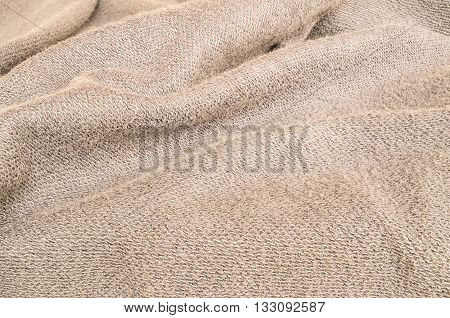 Closeup surface wrinkled brown jacket fabric background