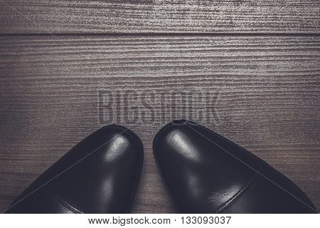 shy man standing on the wooden floor background