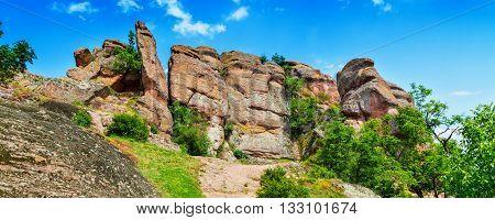 Vibrant panorama of Belogradchik cliff rocks near ancient Kaleto fortress, Bulgaria