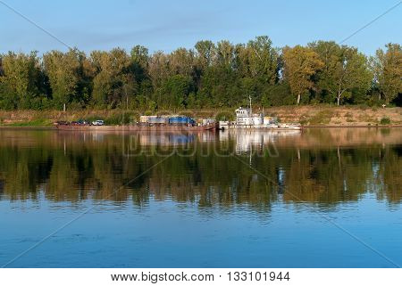 near Malmyzh, Russia - September 3, 2009: The car ferry sails away from the coast to cross the Vyatka River