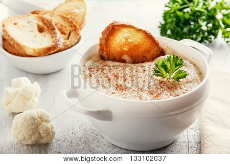 Soup puree cream with cauliflower and croutons