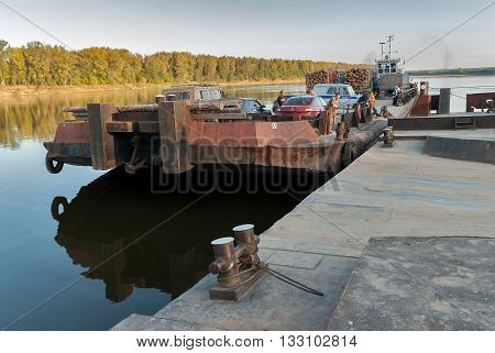 Malmyzh, Russia - September 3, 2009: The car ferry cross Vyatka River and comes nearer to mooring