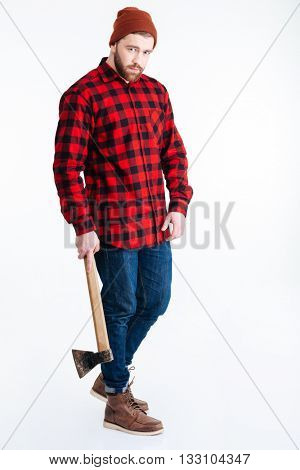 Young hipster guy holding axe and looking at camera isolated on the white background