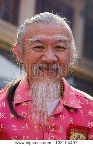 BANGKOK THAILAND - FEBRUARY 09 2016 : Unknown Thai old man during the celebration of Chinese New Year and Valentine's Day in Yaowarat street Chinatown