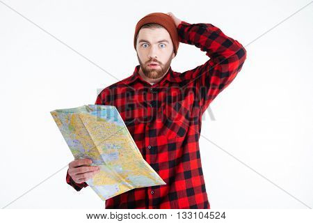 Handsome bearded young man thinking about something isolated on the white background