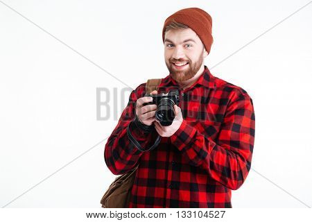 Handsome young man holding digital camera isolated on the white background