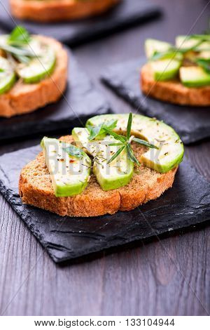 Toast With Avocado, Herbs On Slate Board