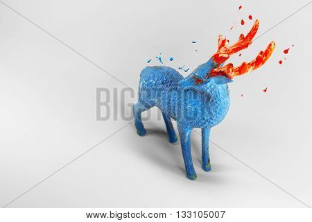 Magic blue deer with melting orange horns