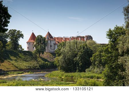 An amazing view of a Bauska castle in rural surroundings
