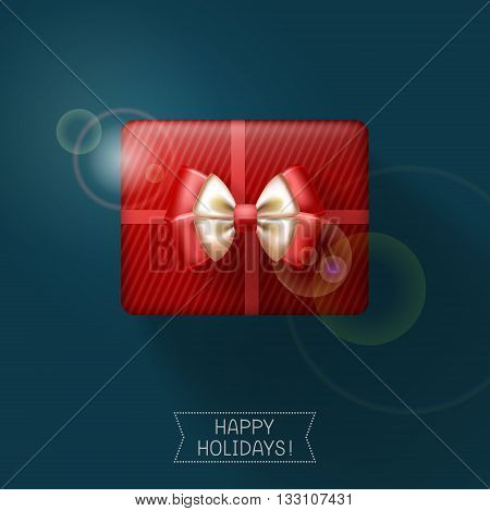 Red gift box tied with ribbon and decorated with bow on dark background. Holiday congratulations below
