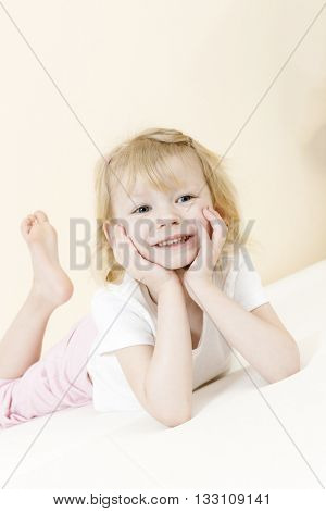 portrait of lying little girl