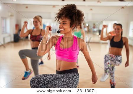 Attractive Afro-American girl on fitness training