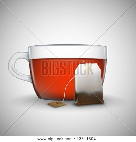 Cup of black tea with bag of tea on white background. Bag of black tea. Cup of tea isolated.