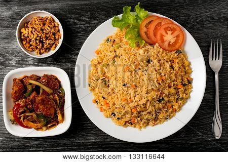 Sri Lankan fried rice with fish curry and cashew nuts