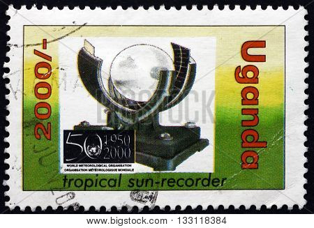 UGANDA - CIRCA 2001: a stamp printed in the Uganda shows Tropical Sun Recorder circa 2001