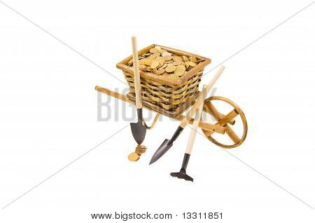the cart of money with garden tools isolated over white