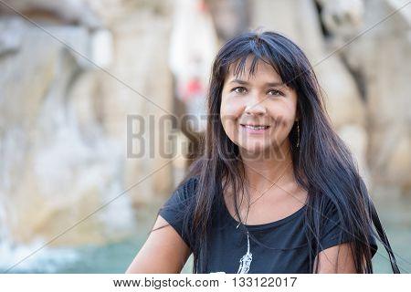 nice girl posing in the famous Navona square in Rome Italy