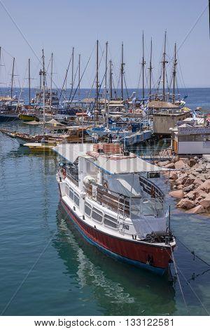 Eilat, Israel - may 09, 2015: Pleasure boat in the port of Eilat