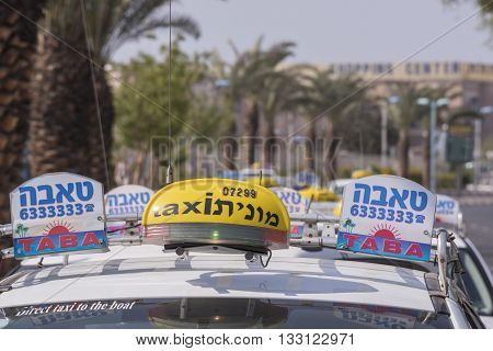 Eilat, Israel - may 09, 2015:  taxis waiting outside of the airport of Eilat in southern Israel