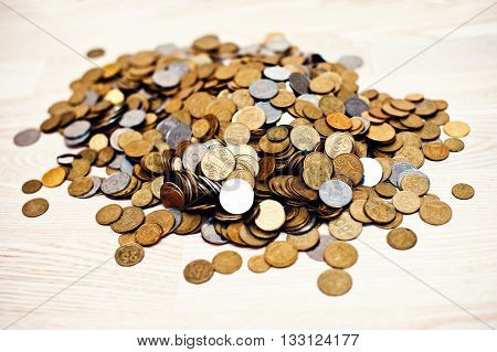 Mountain coins on white wooden deck background