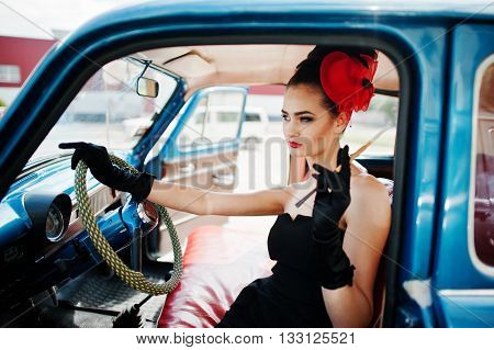 Portrait Of Beautiful Sexy Fashion Girl Model With Bright Makeup In Retro Style Sitting In Vintage C