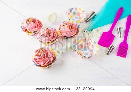 Pink homemade cupcakes and cookware. Birthday cupcakes. Homemade cupcake. Sweet dessert. Sweet pastry. Gourmet cupcakes. Sweet cupcake.