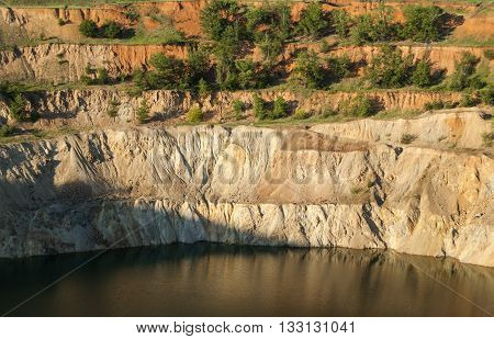 Trench filled with water at bottom of abandoned copper mine