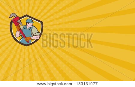 Business card showing illustration of a plumber wearing hat running holding giant monkey wrench looking to the side viewed from front set inside shield crest on isolated background done in cartoon style.